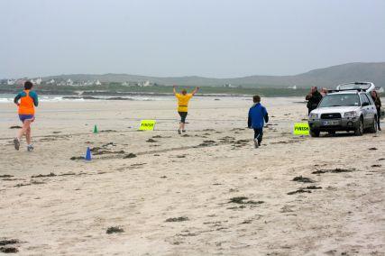 Tiree half marathon crossing the finish line! May '14